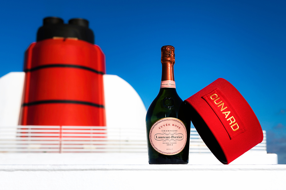A Cunard bell boy's cap pictured with Laurent-Perrier Cuv&eacute;e Ros&eacute; Champagne on board Cunard's ocean liner Queen Mary 2 in Southampton today. **RETOUCHED VERSION**<br /> Picture date: Friday December 15, 2017.<br /> Photograph by Christopher Ison &copy;<br /> 07544044177<br /> chris@christopherison.com<br /> www.christopherison.com