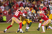 12 January 2013: Wide receiver (89) James Jones of the Green Bay Packers catches a pass and is tackled by the San Francisco 49ers during the second half of the 49ers 45-31 victory over the Packers in an NFL Divisional Playoff Game at Candlestick Park in San Francisco, CA.