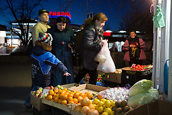 Crimea one day before the referendum. People buy fruits in a small fruit shop one day before the refedendum in Simferopol, . Saturday, 15th March 2014. Picture by Daniel Leal-Olivas / i-Images