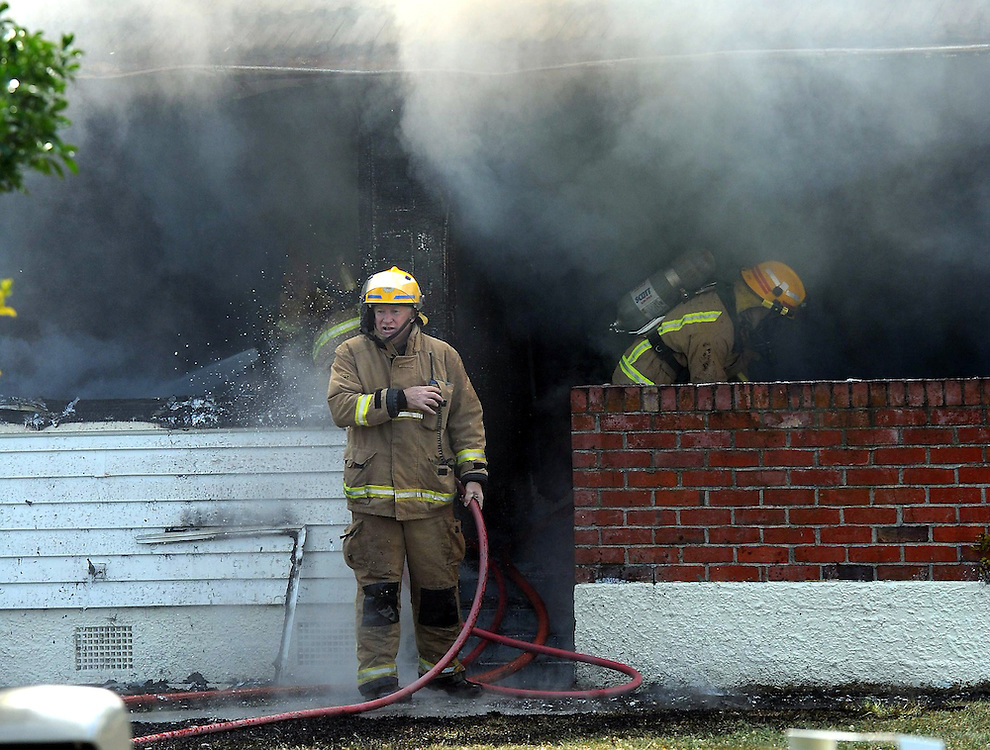 Firefighters work to extinguish a house fire, Seddon Cresent, Napier, New Zealand, Monday, December 10, 2012. Credit:SNPA / Kerry Marshall