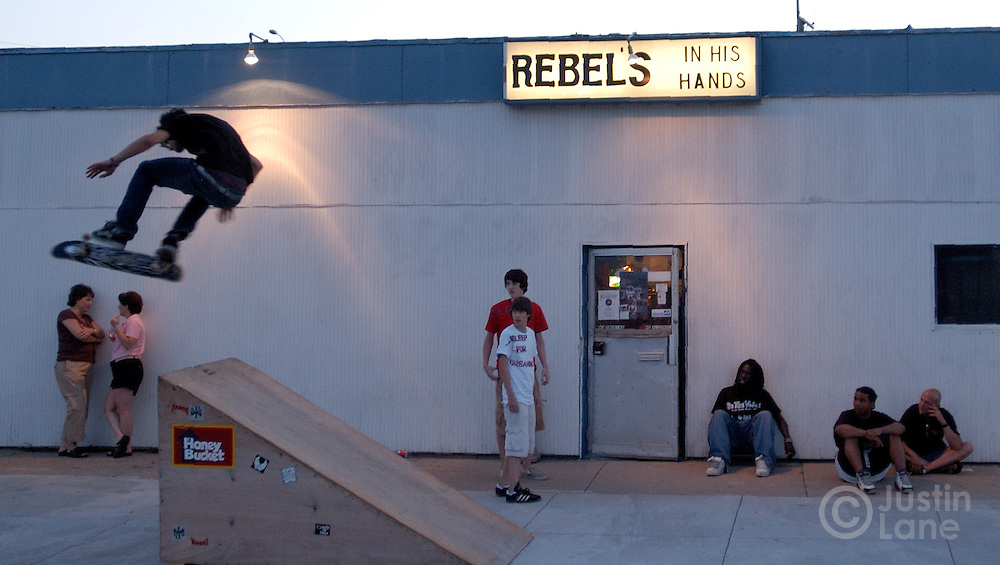 A skateboarder jumps outside of Rebels, a one-time biker bar-turned-Christian club, during an event put on by the Extreme Tour, a travelling ministry of skateboarders and rock music, in Council Bluffs, IO, on Wednesday July 6, 2005. The tour is made up of volunteers who travel across the country evangelizing to at-risk youth.