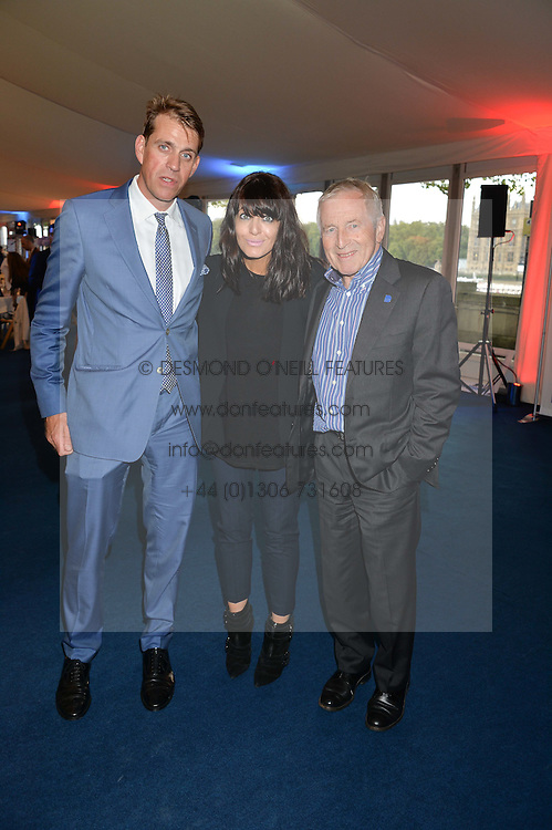 Left to right, BEN ELLIOT, CLAUDIA WINKLEMAN and JONATHAN DIMBLEBY at the World's Greatest Quiz Night in aid of the Quintessentially Foundation and Dimbleby Cancer Care held at the Riverside Parliament Panorama marquee at St Thomas' Hospital, Westminster Bridge Road, Londonon 15th September 2015.