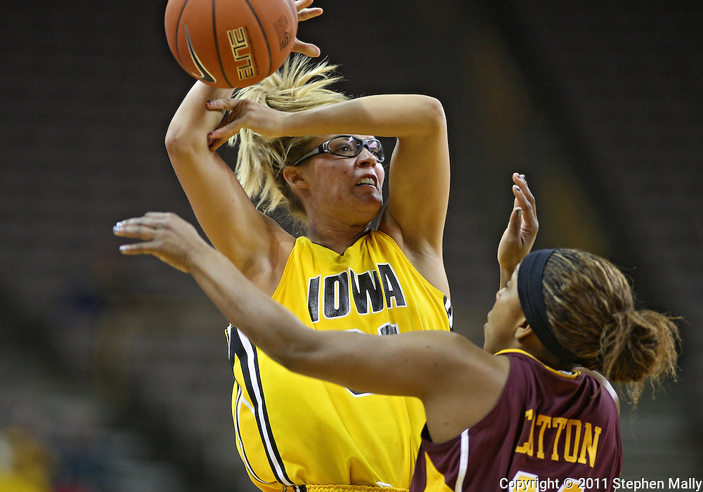 February 10 2011: Iowa Hawkeyes guard/forward Hannah Draxten (31) loses the ball as Minnesota Golden Gophers guard Leah Cotton (11) knocks it away during the first half of an NCAA women's college basketball game at Carver-Hawkeye Arena in Iowa City, Iowa on February 10, 2011. Iowa defeated Minnesota 64-62.
