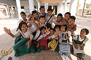 School children pose for the camera in Mandalay, Burma (Myanmar).