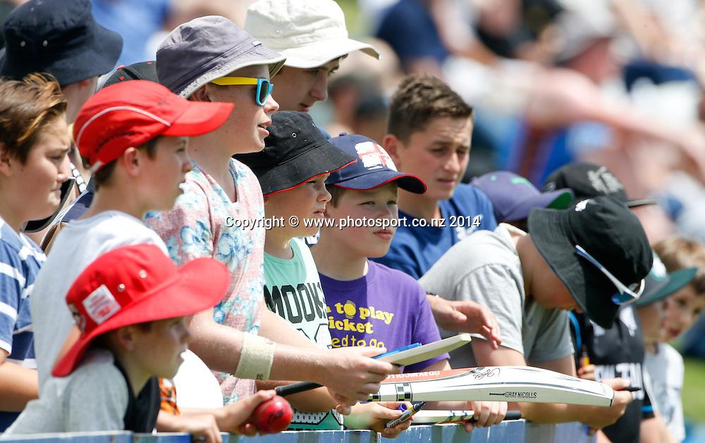 Fans wait to get bats signed. Day 2, ANZ Boxing Day Cricket Test, New Zealand Black Caps v Sri Lanka, 27 December 2014, Hagley Oval, Christchurch, New Zealand. Photo: John Cowpland / www.photosport.co.nz