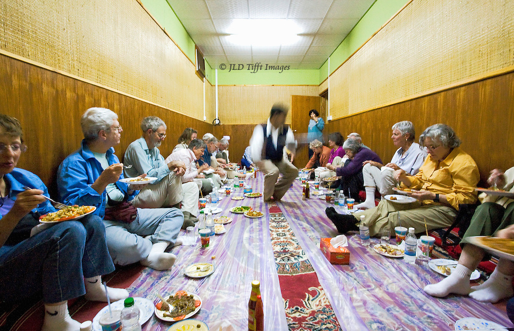 Tourists at an Omani lunch served on the floor.