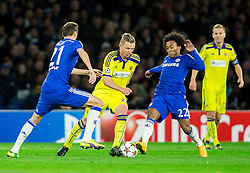 Dare Vrsic of Maribor between Nemanja Matić of Chelsea and Willian of Chelsea during football match between Chelsea FC and NK Maribor, SLO in Group G of Group Stage of UEFA Champions League 2014/15, on October 21, 2014 in Stamford Bridge Stadium, London, Great Britain. Photo by Vid Ponikvar / Sportida.com