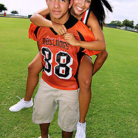 Cheerleader and football player together as couple.