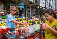 YANGON, MYANMAR - CIRCA DECEMBER 2013: Merchant selling tea and juices in the street market of Yangon.