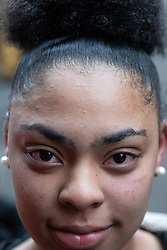 © Licensed to London News Pictures. 04/10/2019. Manchester, UK. MARIA CRUZ FORTES (16) who says she got hit with pepper spray in her eyes . GMP responded to an incident at the Arndale Centre in Manchester City Centre at which batons and CS gas were deployed against school children . GMP say they have arrested two 16 year olds on suspicion of having committed public order offences . Photo credit: Joel Goodman/LNP