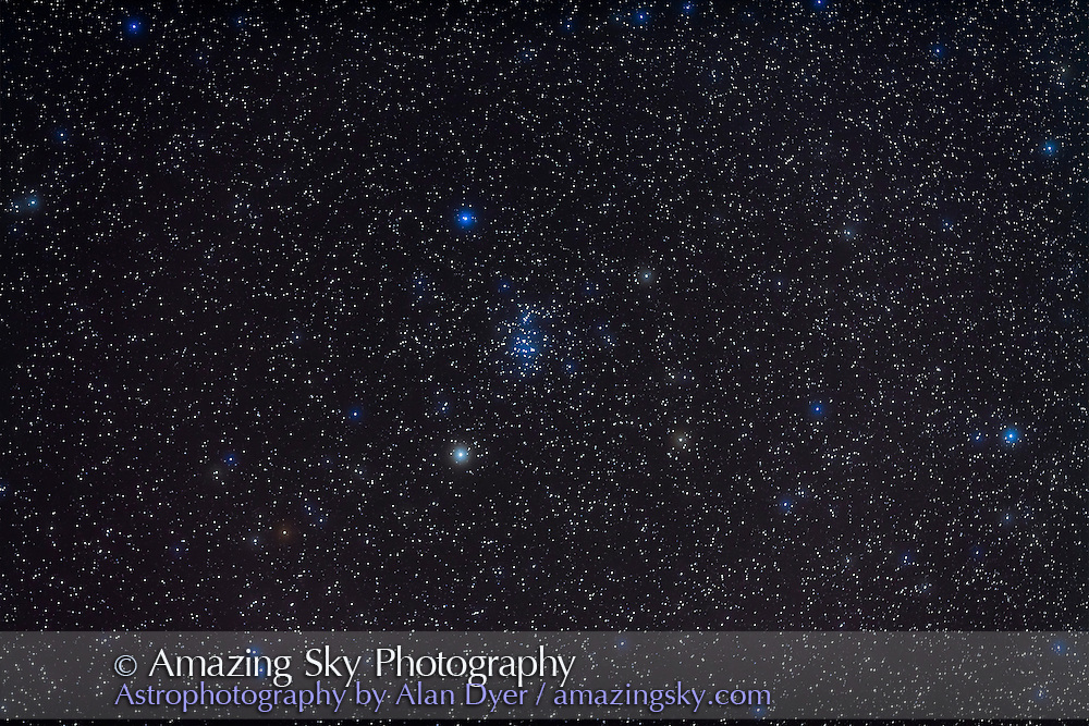 Open cluster M44, the Beehive or Prasepe, in Cancer. Red star at lower left i carbon star X Cancri. This is a stack of 3 x 3 minute exposures in hazy skies with Canon 5D MkII at ISO 800 and Canon 135mm lens at f/2.8. Taken January 6, 2011. Field of view simulates binocular field.