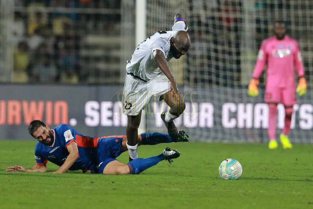 Joffre Gonzalez of FC Goa tackles Mohd Sissoko of FC Pune City during match 8 of the Indian Super League (ISL) season 3 between FC Goa and FC Pune City held at the Fatorda Stadium in Goa, India on the 8th October 2016.<br /> <br /> Photo by Vipin Pawar / ISL/ SPORTZPICS