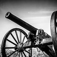 Washington Artillery Park Cannon in New Orleans black and white picture. The civil war cannon monument is an 1861 Parrott Rifle located in the French Quarter near Jackson Square in New Orleans Louisiana