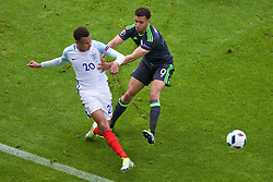 LENS, FRANCE - Thursday, June 16, 2016: Wales' Hal Robson-Kanu in action against England's Dele Alli during the UEFA Euro 2016 Championship Group B match at the Stade Bollaert-Delelis. (Pic by Paul Greenwood/Propaganda)