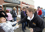 """Mindi McCain (from right) wipes cake and frosting on her daughter, Cheyenne, 8, both of Wellman after finding the $1,700 diamond ring in a cake at Karen Marie Jewelry, 1100 Blairs Ferry Rd NE #116, Cedar Rapids on Saturday February 12, 2011. 25 qualifiers participated in the """"Eat Your Heart Out"""" cake dive. People qualified on air through 104.5 KDAT, in store at Karen Marie Jewelry, and through the American Heart Association. To support American Heart Month, Karen Marie Jewelers has been taking donations for the American Heart Association."""