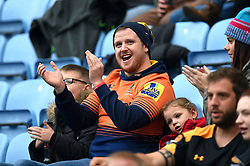 A Worcester Warriors fan in the crowd celebrates - Mandatory byline: Patrick Khachfe/JMP - 07966 386802 - 12/10/2019 - RUGBY UNION - Ricoh Arena - Coventry, England - Wasps v Worcester Warriors - Premiership Rugby Cup
