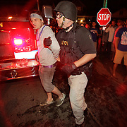 March 31, 2012 - Lexington, Kentucky, USA - A Lexington police officer detains a University of Kentucky basketball fan during celebrations of their team's victory over the University of Louisville in Lexington, Ky., on March 31, 2012. The win for Kentucky advances them to the championship game of the NCAA tournament in New Orleans. Fans took to the streets and in burned couches, turned over a car and ending with a handful of arrests. (Credit image: © David Stephenson/ZUMA Press)