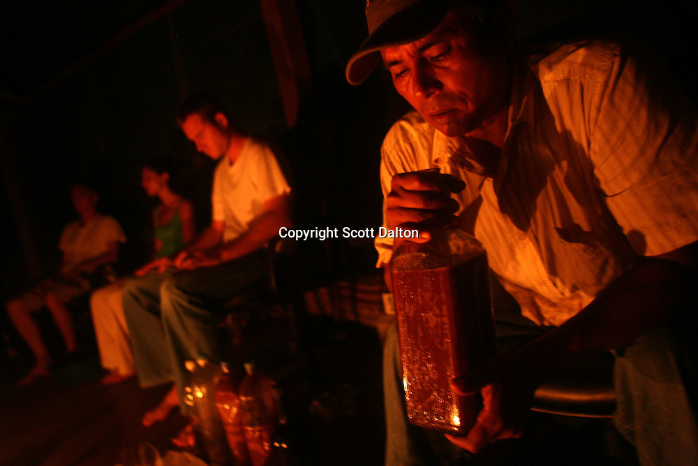 Alberto Torres Davila, master shaman, prepares a bottle of ayahuasca from consumption during a ceremony at the Blue Morpho camp located about one hour outside of Iquitos in the Peruvian Amazon, on August 15, 2007. (Photo/Scott Dalton).