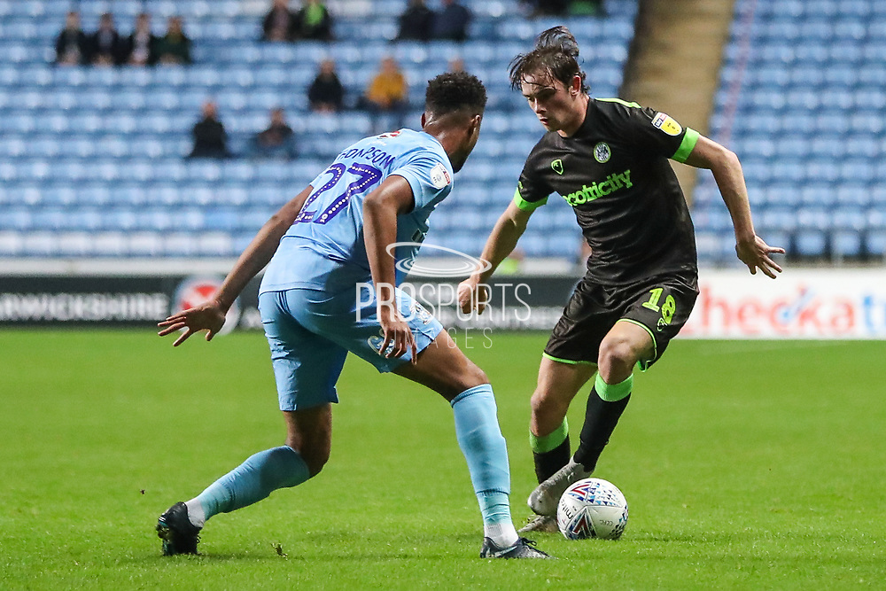 Forest Green Rovers Theo Archibald(18) takes on Coventry City defender Dujon Sterling (17) on loan from Chelsea,  during the EFL Trophy match between Coventry City and Forest Green Rovers at the Ricoh Arena, Coventry, England on 9 October 2018.