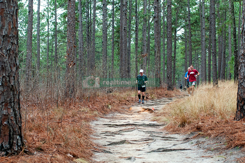 January 19, 2019 - Southern Pines, North Carolina, US - Jan. 19, 2019 - Southern Pines N.C., USA - Lee Starnes, Granite Falls, North Carolina, Ryan Moore, Spring Lake, North Carolina, and Nicholas Drakos, Southern Pines, North Carolina, complete a lap during the 10th Annual Weymouth Woods 100km ultra marathon at the Weymouth Woods Nature Preserve. Runners needed to complete 14 laps of the 4.47 mile course for 62.58 miles in under the 20-hour time allotment. (Credit Image: © Timothy L. Hale/ZUMA Wire)