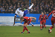 Moussa Diarra fouled by Steven Davies during the The FA Cup 3rd round match between Barrow and Rochdale at Holker Street, Barrow, United Kingdom on 7 January 2017. Photo by Daniel Youngs.