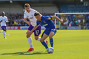 AFC Wimbledon midfielder Callum Reilly (33) battles for possession with Shrewsbury Town defender Donald Love (17) during the EFL Sky Bet League 1 match between AFC Wimbledon and Shrewsbury Town at the Cherry Red Records Stadium, Kingston, England on 14 September 2019.