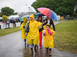 © Licensed to London News Pictures. 12/05/2018. Windsor, UK. A family wrapped in in ponchos during cold and damp conditions in the afternoon at day 4 of the 75th Royal Windsor Horse Show . The five day event takes place in the grounds of Windsor Castle. Photo credit: Ben Cawthra/LNP