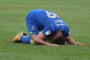 AFC Wimbledon midfielder Tom Soares (19) with head on pitch during the EFL Sky Bet League 1 match between AFC Wimbledon and Scunthorpe United at the Cherry Red Records Stadium, Kingston, England on 7 April 2018. Picture by Matthew Redman.