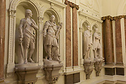 The statues of Sir Eyre-Coote, K.B. by Thomas Banks (1788) and   <br /> Marquis Cornwallis, K.G. by John Bacon, Senior (1791) in the Gurkha Stair in the former India Office, which was part of the Foreign and Colonial Office (now the Foreign and Commonwealth Office), Whitehall, London. on 17th September 2017, in Whitehall, London, England. The main Foreign Office building is in King Charles Street, and was built by George Gilbert Scott in partnership with Matthew Digby Wyatt and completed in 1868 as part of the new block of government offices which included the India Office and later (1875) the Colonial and Home Offices. George Gilbert Scott was responsible for the overall classical design of these offices but he had an amicable partnership with Wyatt, the India Office&rsquo;s Surveyor, who designed and built the interior of the India Office.