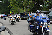 "Members of the Thin Blue Line Foundation and Law Enforcement Motorcycle Club arrive at Stevens ES for ""Bikes for Excellence."""