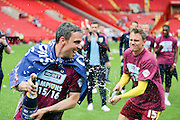 Burnley defender, Michael Duff (04) getting soaked in champagne during the Sky Bet Championship match between Charlton Athletic and Burnley at The Valley, London, England on 7 May 2016. Photo by Matthew Redman.