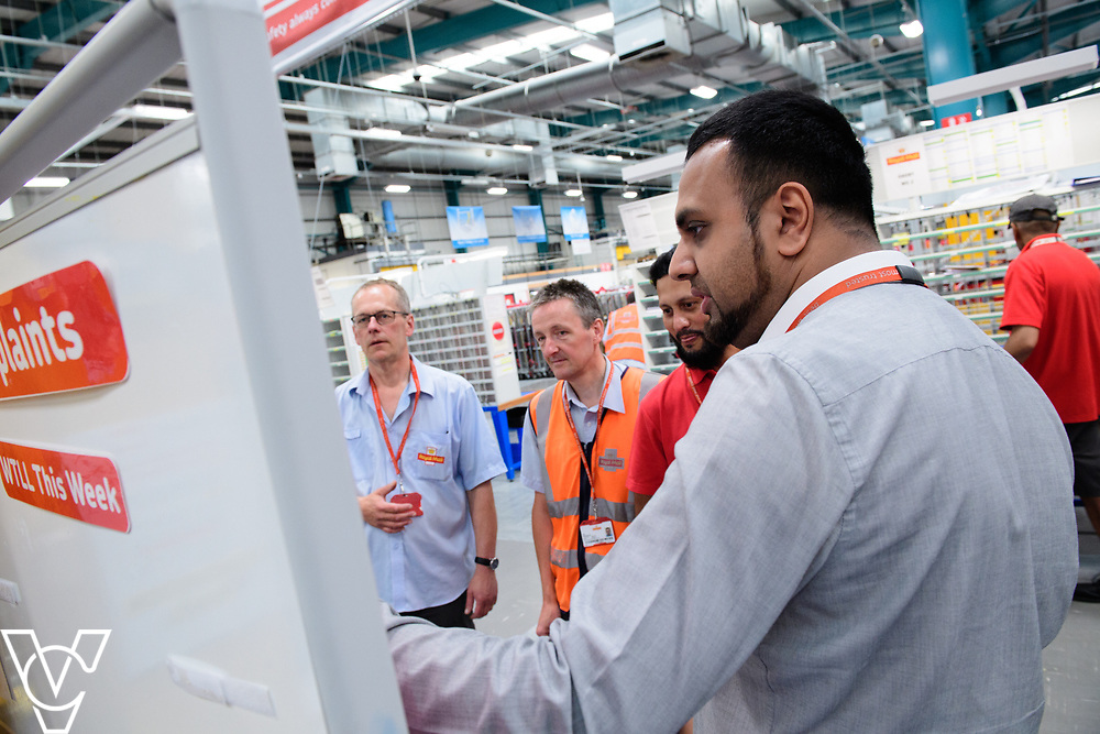 Two delivery offices, Oadby and Leicester South, which are both based inside the Leicester Mail Processing Unit building, have passed the penultimate gateway of One Plan.  One Plan is a business programme designed to have a standardised operation of excellence.  Pictured is Shahbaaz Khan, right, working with, from left, Keith Bedford, Ian Rosewarne and Shuaib Chowdhury.<br /> <br /> Picture: Chris Vaughan Photography<br /> Date: July 7, 2017