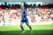 Wigans No 4 David Perkins Leaves The Field After Being Sent Off For A Foul during the Sky Bet League 1 match between Doncaster Rovers and Wigan Athletic at the Keepmoat Stadium, Doncaster, England on 16 April 2016. Photo by Stephen Connor.