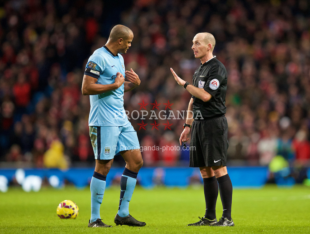 MANCHESTER, ENGLAND - Sunday, January 18, 2015: Manchester City's captain Vincent Kompany is spoken to by referee Mike Dean during the Premier League match against Arsenal at the City of Manchester Stadium. (Pic by David Rawcliffe/Propaganda)