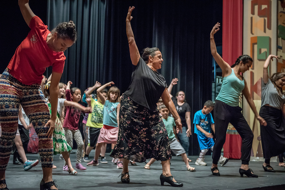 rer053117d/metro/May 31, 2017/Albuquerque Journal<br /> The City of Albuquerque, in partnership with the National Institute of Flamenco presented a fun and interactive flamenco event for children 6 years old and up. Pictured is National Institute of Flamenco instructor Eva Encinias Sandoval(Cq), middle, leading a workshop for kids Wednesday afternoon at the Kimo Theater. <br /> Roberto E. Rosales/Albuquerque Journal