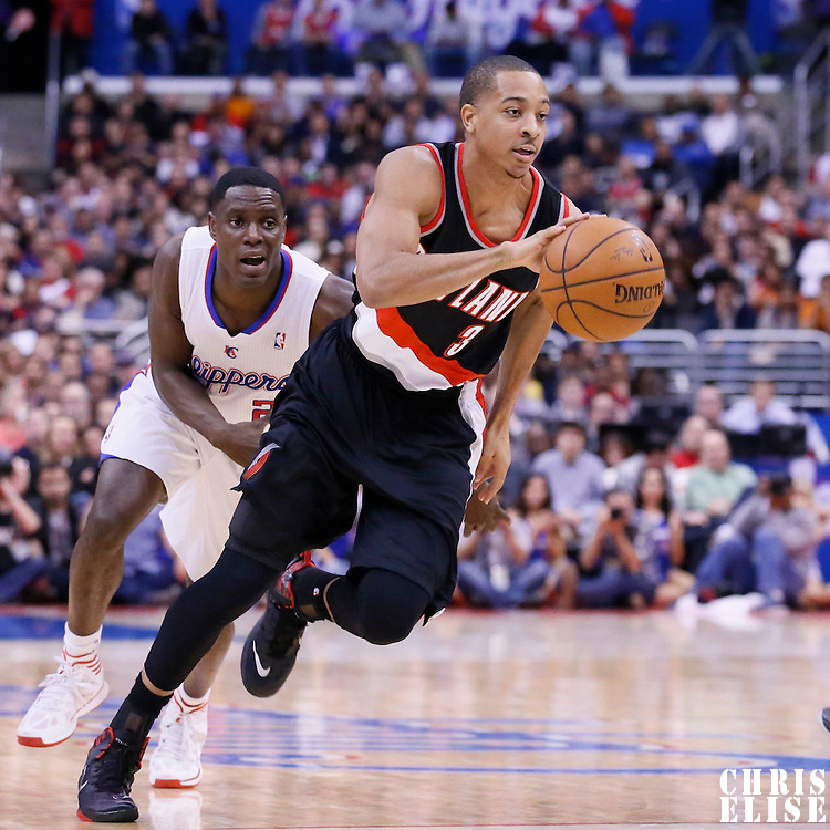 12 February 2014: Portland Trail Blazers shooting guard C.J. McCollum (3) drives past Los Angeles Clippers point guard Darren Collison (2) during the Los Angeles Clippers 122-117 victory over the Portland Trail Blazers at the Staples Center, Los Angeles, California, USA.