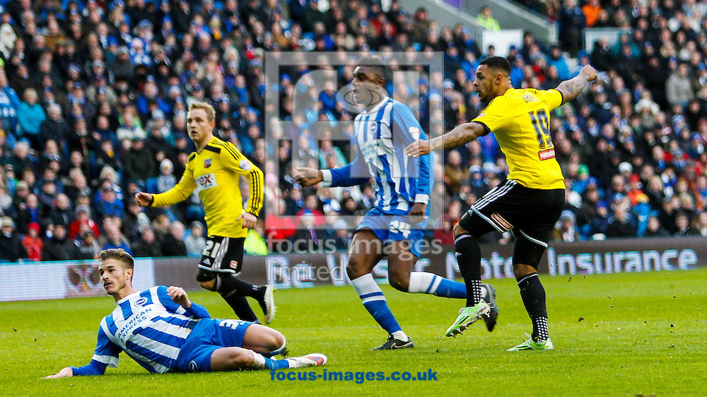 Andre Gray of Brentford scores the opening goal during the Sky Bet Championship match between Brighton and Hove Albion and Brentford at the American Express Community Stadium, Brighton and Hove<br /> Picture by Mark D Fuller/Focus Images Ltd +44 7774 216216<br /> 17/01/2015