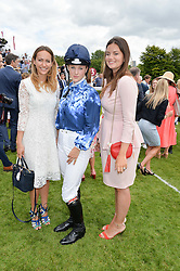 Left to right, LAVINIA BRENNAN, LEONORA SMEE and LADY NATASHA FINCH at the Qatar Goodwood Festival - Ladies Day held at Goodwood Racecourse, West Sussex on 30th July 2015.