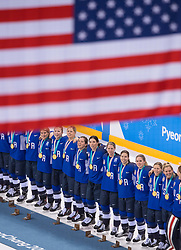 February 22, 2018 - Pyeongchang, South Korea - US Olympic Women's hockey team members watch the US flag raised during a medal ceremony celebrating their gold medal win in the Women's Gold Medal Ice Hockey game Thursday, February 22, 2018 at Gangneung Hockey Centre at the Pyeongchang Winter Olympic Games. Photo by Mark Reis, ZUMA Press/The Gazette (Credit Image: © Mark Reis via ZUMA Wire)