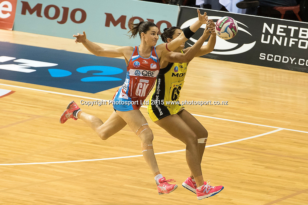 Swifts' Sharni Layton (L) makes an intercept on a pass to Pulse's Ameliaranne Wells during the ANZ Championship - Pulse v Swifts netball match at the TSB Arena in Wellington on Saturday the 25th of April 2015. Photo by Marty Melville / www.Photosport.co.nz