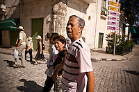 "Cristina Apón Peña, director of the Residencia del Anciano Chino, leads the Chinese-Cuban seniors to watch tai chi in Plaza Vieja, in Old Havana, Cuba, on Saturday, April 26, 2008. ""There were many Chinese that traveled to Cuba with the dream of finding fortune,"" said  Peña. ""They left behind young wives and babies in hopes of fulfilling that dream and returning to China soon.""."