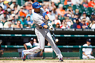 May 22, 2014; Detroit, MI, USA; Texas Rangers right fielder Alex Rios (51) at bat against the Detroit Tigers at Comerica Park. Mandatory Credit: Rick Osentoski-USA TODAY Sports