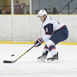 WELLINGTON, - Dec 11, 2015 -  Exhibition Game 2- Team USA vs Team Canada East at the 2015 World Junior A Challenge at the Wellington District Community Centre, ON. Ryan Zuhlsdorf #5 of Team United States skates with the puck during the second period.<br /> (Photo: Andy Corneau / OJHL Images)
