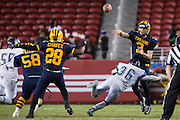 Milpitas quarterback Oliver Svirsky, 3, passes the ball to running back Cros Chavez, 28, against Valley Christian High School during Friday Night Lights at Levi's Stadium in Santa Clara, California, on September 18, 2015.  Milpitas went on to lose 22-21 against Valley Christian.  (Stan Olszewski/SOSKIphoto)