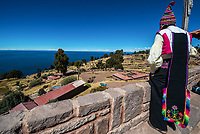 Puno, Peru - July 25, 2013: man looking away in the peruvian Andes at Taquile Island on Puno Peru at july 25th, 2013.