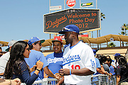 LOS ANGELES, CA - JUNE 30:  Tony Gwynn #10 of the Los Angeles Dodgers greets fans at fan photo day before the game against the New York Mets on Saturday, June 30, 2012 at Dodger Stadium in Los Angeles, California. The Mets won the game in a 5-0 shutout. (Photo by Paul Spinelli/MLB Photos via Getty Images) *** Local Caption *** Tony Gwynn