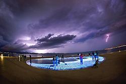 11.09.2013, Hafen, Zadar, CRO, Sonnengruss (Pozdrav suncu) vom Architekten Nikola Basic, er besteht aus dreihundert mehrschichtigen Glasplatten auf dem gleichen Niveau wie die gepflasterte Promenade in einem Kreis von 22 Metern Durchmesser, im Bild Gewitter im Hafen von zadar // during a thunderstorm in the Port of Zadar, Croatia on 2013/09/11. EXPA Pictures © 2013, PhotoCredit: EXPA/ Pixsell/ Filip Brala<br /> <br /> ***** ATTENTION - for AUT, SLO, SUI, ITA, FRA only *****