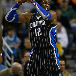 January 12, 2011; New Orleans, LA, USA; Orlando Magic center Dwight Howard (12) against the New Orleans Hornets during the first quarter at the New Orleans Arena.   Mandatory Credit: Derick E. Hingle