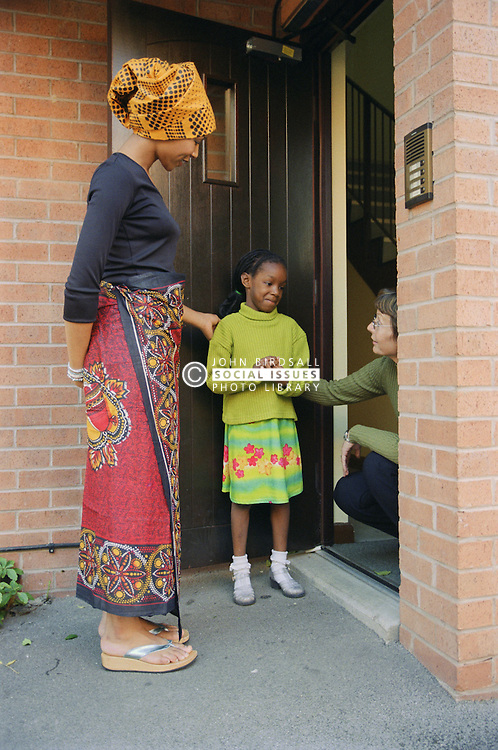 Young girl arriving at carer's house; meeting carer,