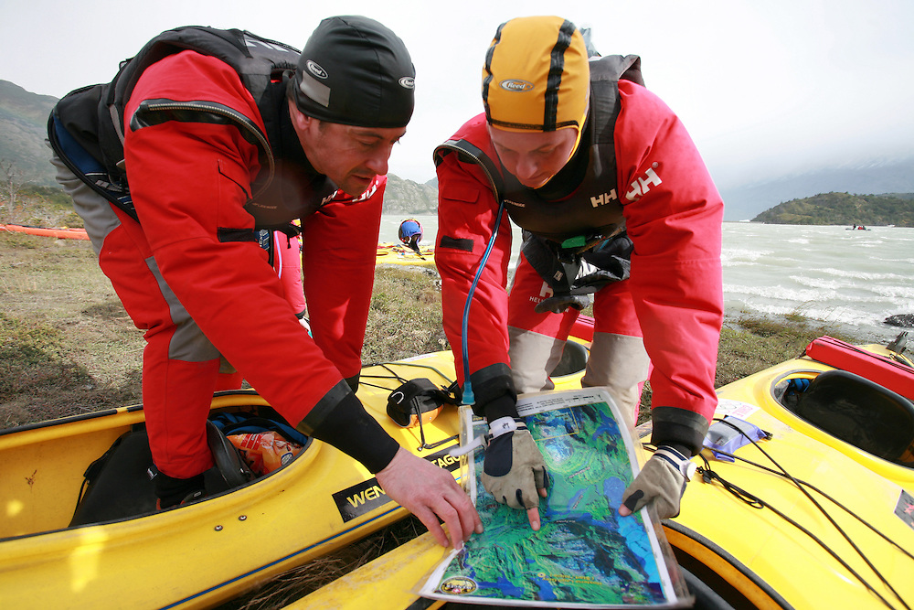 The British Team Helly Hansen Prunesco members Andy Wilson and Nicola Macleod studying the map at the start of the 2009 Wenger Patagonia Expedition Race in Patagonia, Chile, South America .Copyrighted work .Permission must be sought before use of this image..Alex Ekins .0114 2630277.07901883 994